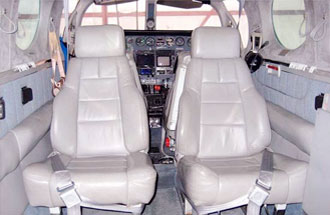 Book a private airplane charter flight, such as on a Cessna 340 twin piston plane, for a flight in Canada.